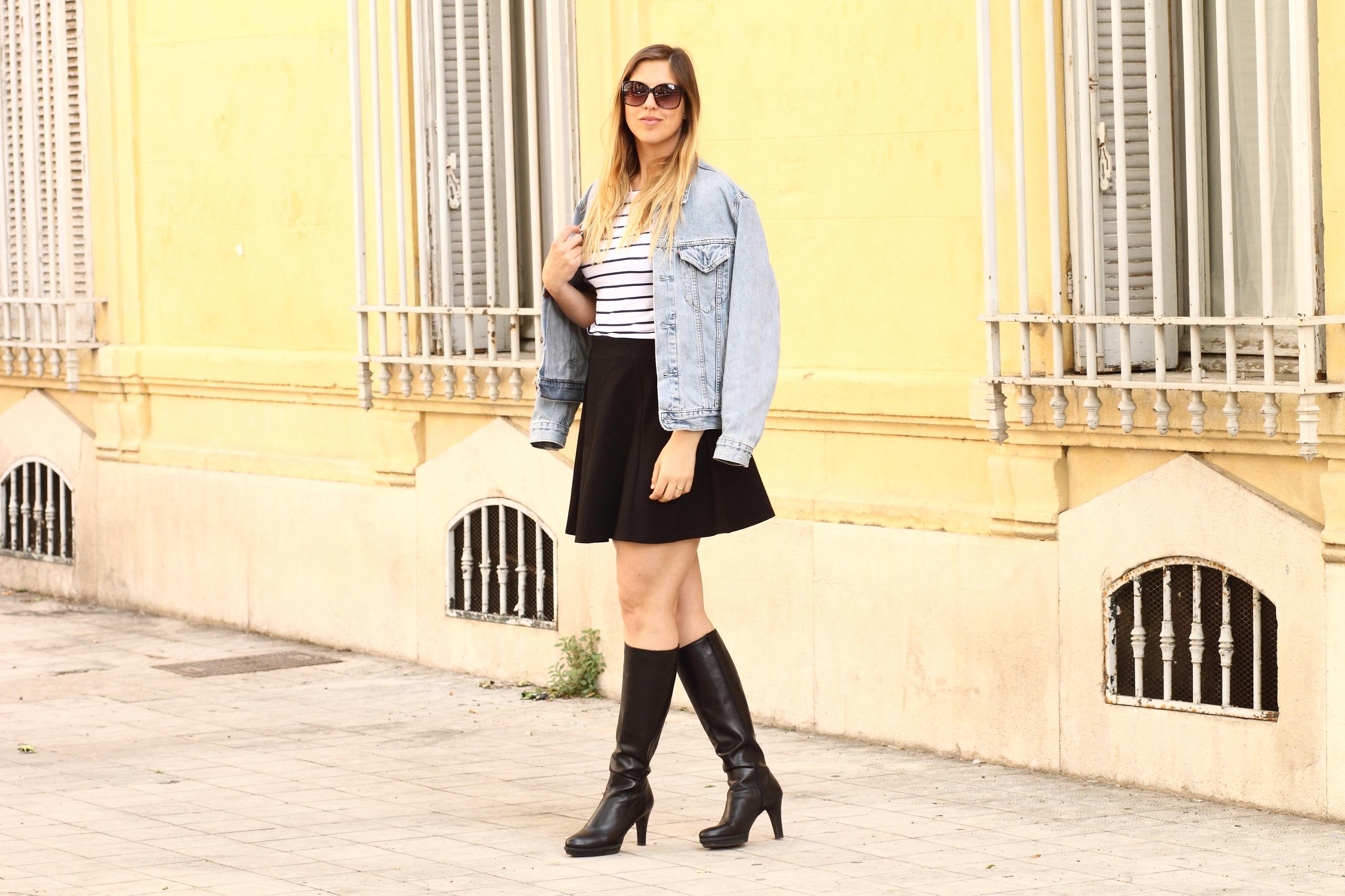 black kneehigh boots and black a line skirt