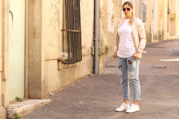 pale pink bomber jacket and jeans stradivarius